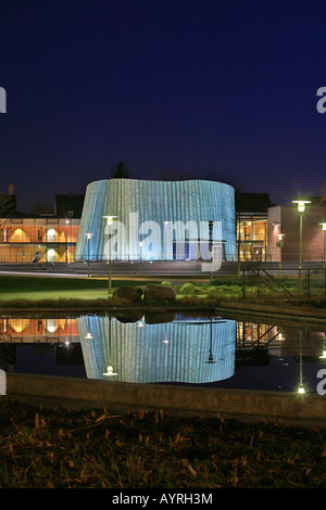 New music school reflected in a pond at dusk, unique architecture, Fellbach, Stuttgart, Baden-Wuerttemberg, Germany - Stock Photo