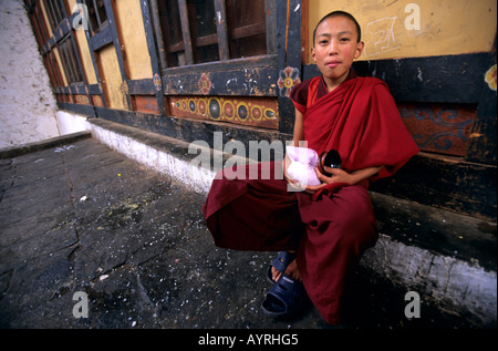 Portrait of a young buddhist monk in the Paro dzong, Bhutan - Stock Photo