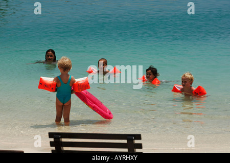 Netherlands Antilles Bonaire group of young friends in the shallow water of lac bay sorobon - Stock Photo