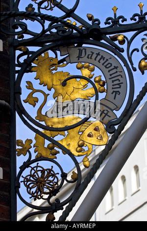 Golden lion emblem at the Patriotischen Gesellschaft building, Hamburg, Germany - Stock Photo