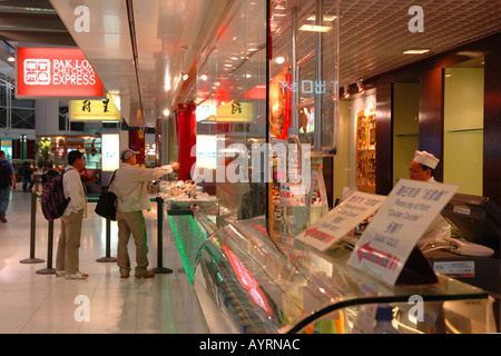 Fast food counter at Hong Kong's International Airport - Stock Photo