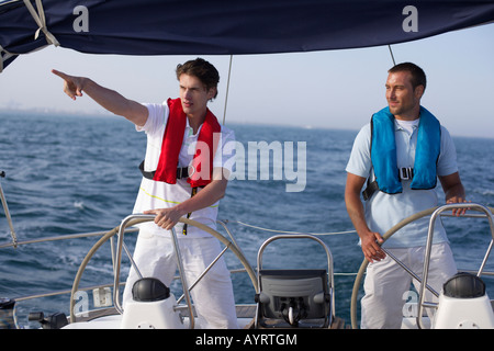 Two men steering a boat - Stock Photo