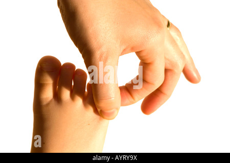 Mother touching her child's foot - Stock Photo