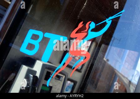BT telephone box or booth, British Telecom phone box, Britain UK - Stock Photo