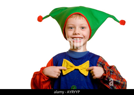 Four-year-old boy dressed up as a harlequin (court jester) - Stock Photo
