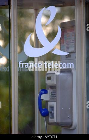 France Telecom public telephone booth, phone box, France - Stock Photo