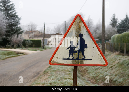 a close up of old pedestrian warning sign in small french village in the dordoigne - Stock Photo