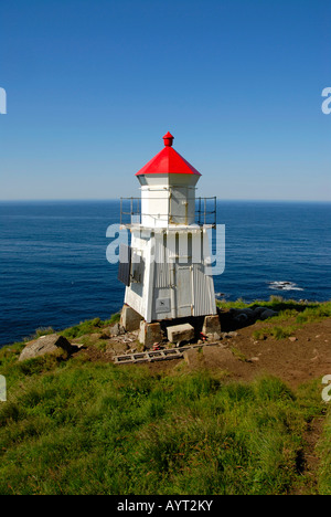 Lonely little white lighthouse with red roof, Lofoten, Norway - Stock Photo