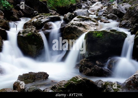 Water spray over rocks, Kuhflucht Falls, Farchant, Bavaria, Germany, Europe - Stock Photo