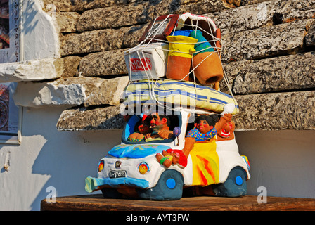 Sculpture of a family going on vacation with a fully loaded car, Alberobello, Valle d'Itrea, Bari Province, Apulia, - Stock Photo