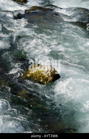 Fast-flowing mountain stream rushing over rocks near Fischbachau, Bavaria, Germany - Stock Photo