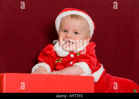6-month-old little boy wearing Santa Claus costume - Stock Photo