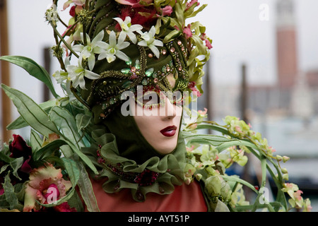 Red and green costume and mask, Carnevale di Venezia, Carneval in Venice, Italy - Stock Photo