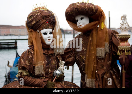 Two brown costumes and masks, Carnevale di Venezia, Carnival in Venice, Italy - Stock Photo