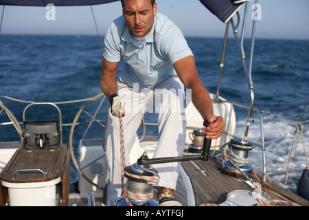 Man working on a yacht, truncated - Stock Photo