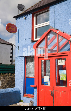North Wales UK Closed village post office in colourful red and blue cottage building - Stock Photo