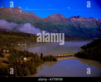 The Alaska Railroad train crossing the trestle over Train Lake at Moose Pass in Alaska. - Stock Photo