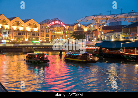 Shopping mall stores and restaurants on waterfront at Clarke Quay Singapore - Stock Photo