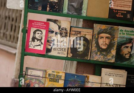 Books on Che Guevara on a shelf on the sidewalk Havana Cuba - Stock Photo