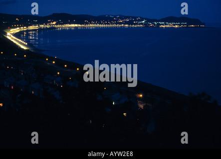 Night view of Colwyn bay illuminated with esplanade street lights - Stock Photo