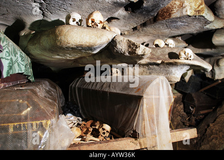 Indonesia: Coffins and Skulls in a burial chamber of the caves graves in Londa, Sulawesi Island - Stock Photo