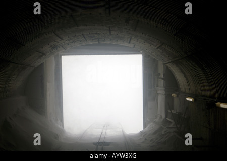 Cairngorm Mountain Railway, from train about to leave the Upper Station tunnel in a snowstorm. - Stock Photo