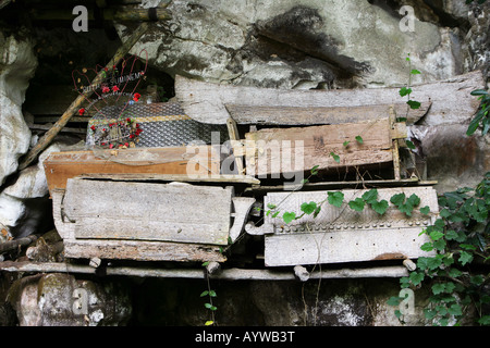 Indonesia: Coffins in a burial chamber of the caves graves in Londa, Sulawesi Island - Stock Photo
