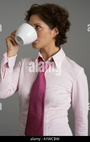 Businesswoman drinking a cup of coffee - Stock Photo