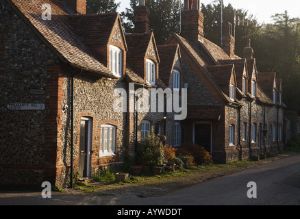 A row of traditional terraced Buckinghamshire brick and flint built cottages in Hambleden village - Stock Photo