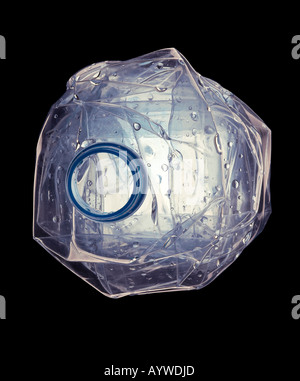 A crushed empty water bottle on a black background - Stock Photo
