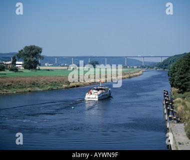 Ausflugsschiff auf der Ruhr vor der Ruhrtalbruecke in Muelheim an der Ruhr-Mintard, Ruhrgebiet, Nordrhein-Westfalen - Stock Photo