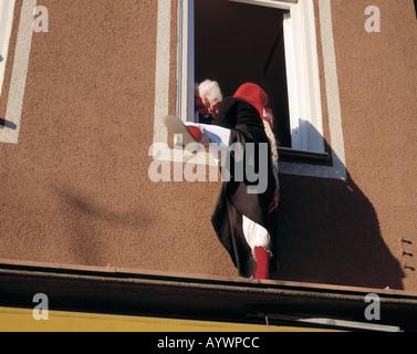 carnival, masks, D-Tuttlingen, Danube, nature reserve Upper Danube, Baden-Wuerttemberg, witch climbs up a house - Stock Photo