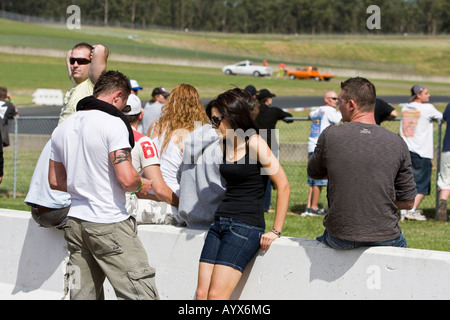 A group of boys and girls waiting for something to happen - Stock Photo