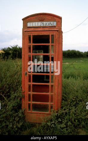 Traditional British Telecom public telephone box, Hoo, Suffolk, UK. - Stock Photo
