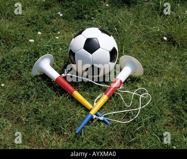 sports, football, ball with two trumpets, symbolic photograph - Stock Photo