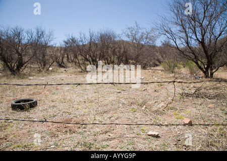 Nogales Arizona The US Mexico border is marked by a barbed wire fence and a discarded tire east of Nogales - Stock Photo