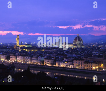 Night view of Florence from Piazzale Michelangelo, with Palazzo Vecchio and Duomo dominating skyline Florence Tuscany - Stock Photo