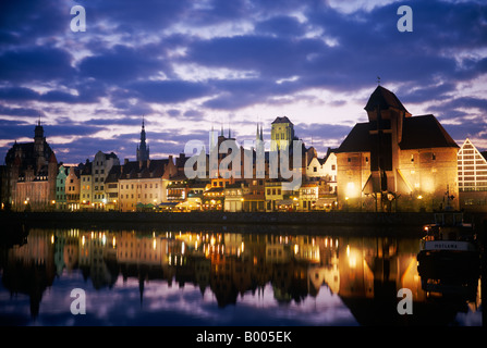 View across the Mottlawa river to the medieval city gate of Gdansk called 'Crane Gate' (Krantor) - Poland, Europe. - Stock Photo