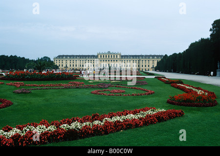 The gardens, Schonbrunn Palace, Vienna, Austria. The sculpted garden space between the palace and the Neptune Well. - Stock Photo