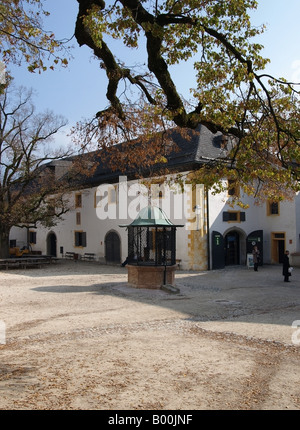 Well in the shade of a 400 year old Linden Tree Salzburg Fortress Festung Hohensalzburg Austria - Stock Photo