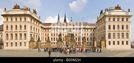 A 2 picture panoramic stitch of the main Entrance to Prague castle with tourists watching the 'changing of the guard'. - Stock Photo