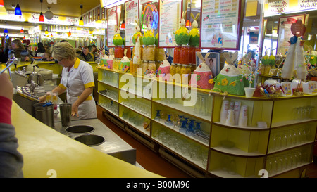 Woman serving at ice cream parlour, interior of the Harbour Bar, Sandside in Scarborough, Yorkshire - Stock Photo