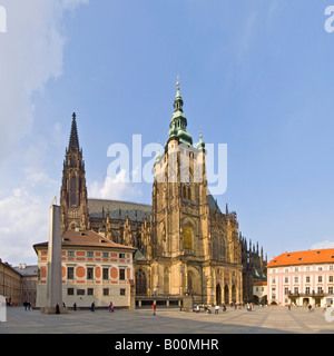 A 2 picture panoramic stitch of tourists around Saint Vitus's Cathedral located within the grounds of Prague Castle. - Stock Photo