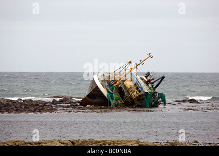 Beached grounded wreck of Banff Fishing Vessel boat BF 380 aground on rocks at Fraserburgh, North East Scotland, - Stock Photo