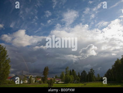 Thunderstorm clouds rising over a residential area , Finland - Stock Photo