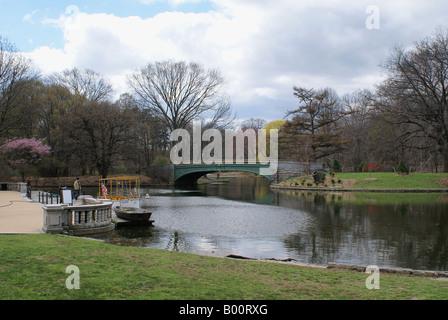 Bridge across a lake in Prospect Park, Brooklyn, NY - Stock Photo