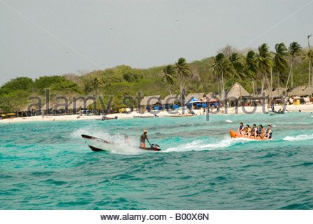 Water sport on the Playa Blanca on the Isla de Baru, Cartagena de Indias, Colombia - Stock Photo