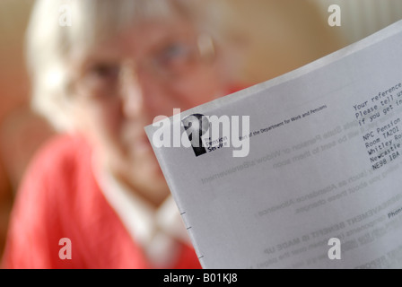 Mature woman with Pension statement - Stock Photo