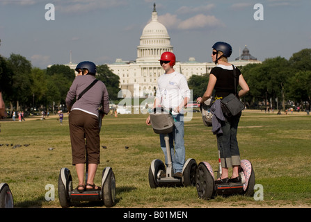 Tourists get ready for a tour on Segway Personal Transporter in Washington, D.C., USA.  Capitol is in background. - Stock Photo