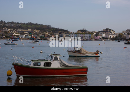 View of Teighmouth back beach from Shaldon beach with boats in foreground - Stock Photo